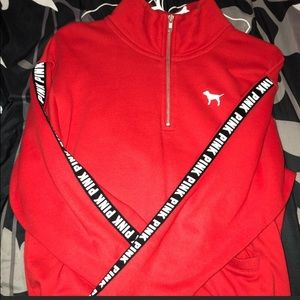 Red sweater with PINK logo on sides